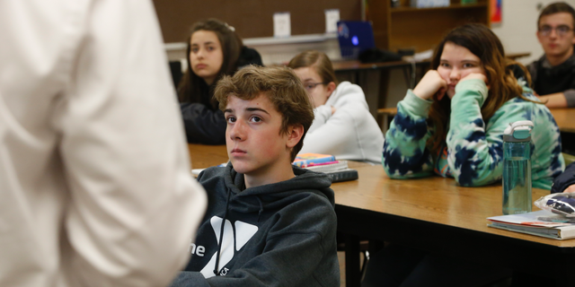 High school freshmen listen to Wexford County prosecutor Jason Elmore talk about consent and criminal sexual conduct on Wednesday, April 17, 2019, in Cadillac, Mich. Among other things, he reminded them that the legal age of consent for sexual contact in the state of Michigan is 16. Most of the students in these classes are younger than that. (AP Photo/Martha Irvine)
