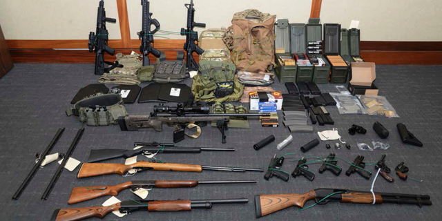 Investigators removed this cache of guns and ammunition from Hasson's Silver Spring, Md. apartment after his arrest in February. (U.S. District Court via AP, File)