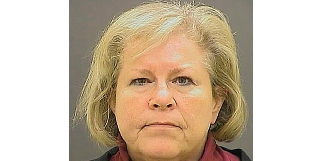 FILE - This undated file photo provided by the Baltimore Police Department shows former Episcopal Bishop Heather Cook. Cook, who fatally struck a bicyclist while drunk and texting behind the wheel more than four years ago, has been released from a Maryland prison. She was the second-highest-ranking Episcopal leader in the mid-Atlantic state when the fatal Baltimore crash occurred two days after Christmas 2014. Her lawyer says she was released Tuesday, May 14, 2019, from the Maryland Correctional Institute for Women. (Baltimore Police Department via AP, File)