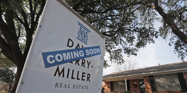 FILE- In this Feb. 20, 2019, file photo a coming soon for sale sign sits in front of a home in the Dallas suburb of Richardson, Texas. On Thursday, May 2, Freddie Mac reports on this week's average U.S. mortgage rates. (AP Photo/LM Otero, File)