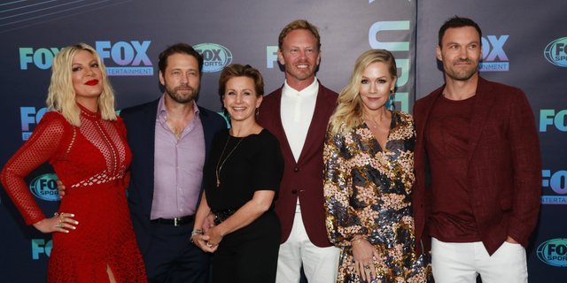 Tori Spelling, from left, Jason Priestley, Gabrielle Carteris, Ian Ziering, Jennie Garth and Brian Austin Green, from the cast of 'BH90210.' (Photo by Andy Kropa/Invision/AP, File)