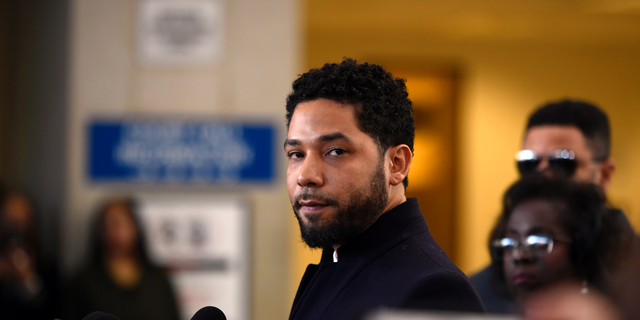 In this March 26, 2019 file photo, Actor Jussie Smollett talks to the media before leaving Cook County Court after his charges were dropped, in Chicago. He now faces new charges following an investigation.