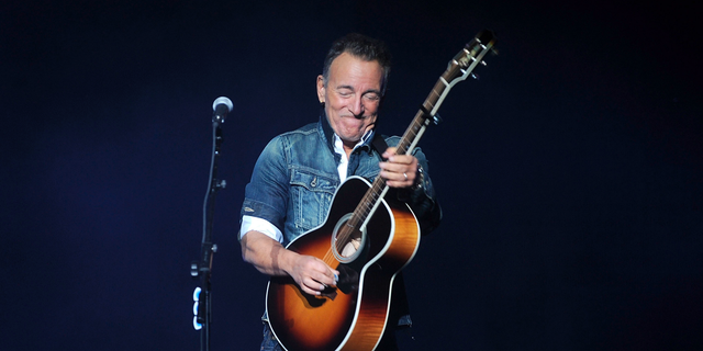 """FILE - In this Monday, Nov. 5, 2018, file photo, Bruce Springsteen performs at the 12th annual Stand Up For Heroes benefit concert at the Hulu Theater at Madison Square Garden in New York. Springsteen is kicking off the Emmys campaign for his Netflix film """"Springsteen on Broadway"""" with an acoustic performance of """"Dancing in the Dark"""" and a deep and wide-ranging chat with filmmaker Martin Scorsese, the two confirmed Sunday, May 5, 2019. (Photo by Brad Barket/Invision/AP, File)"""