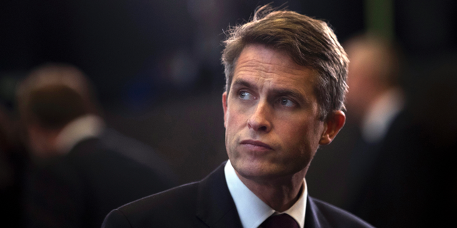 """FILE - In this Thursday, Oct. 4, 2018 file photo, Britain's Defence Minister Gavin Williamson stands in the main chamber during a gathering of NATO defence ministers at NATO headquarters in Brussels. British Defense Secretary Gavin Williamson has been fired Wednesday, May 1, 2019 after an investigation into leaks from a secret government meeting about Chinese telecoms firm Huawei. Prime Minister Theresa May's office says May has """"lost confidence"""" in Williamson. (AP Photo/Francisco Seco, file)"""