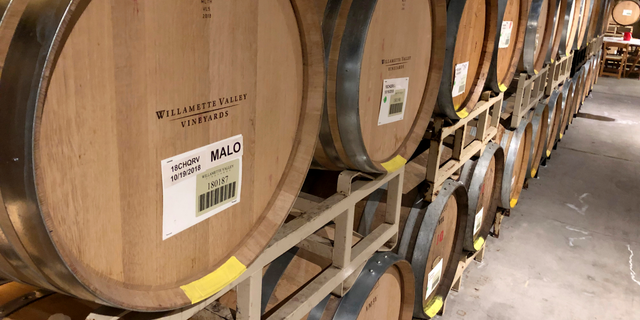 FILE - In this Jan. 25, 2019, photo Chardonnay wine ages in barrels at Willamette Valley Vineyards in Turner, Ore. On May 9, the Labor Department reports on U.S. producer price inflation in April. (AP Photo/Andrew Selsky, File)