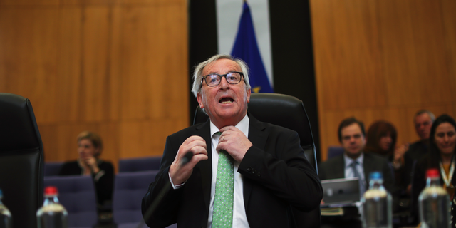 European Commission President Jean-Claude Juncker adjusts his tie prior a College of Commissioners meeting at the European Commission headquarters in Brussels, Tuesday, May 7, 2019. (AP Photo/Francisco Seco)