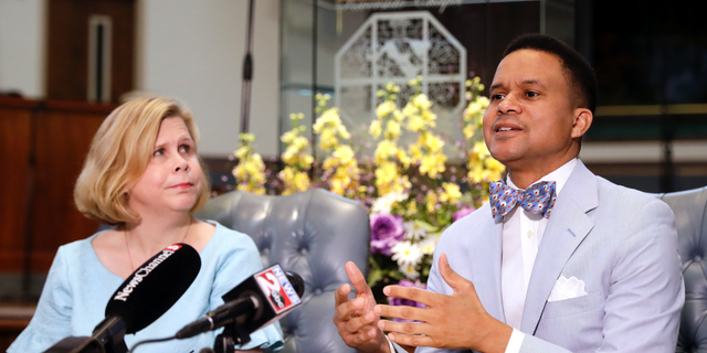 FILE - In an April 3, 2019 file photo, Pastor Furman Fordham, right, speaks on behalf of death row inmate Don Johnson, in Nashville, Tenn. Supporters of Johnson are appealing to Gov. Bill Lee's strong Christian faith in requesting clemency for Johnson, who they say was redeemed by Jesus. At left is Kelley Henry, an assistant federal public defender. (AP Photo/Mark Humphrey, File)