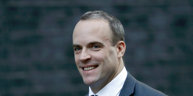 FILE - In this Tuesday, Nov. 13, 2018 file photo, Britain's Secretary of State for Exiting the European Union Dominic Raab arrives for a cabinet meeting at 10 Downing Street in London. Prime Minister Theresa May's announcement that she will leave 10 Downing Street has set off a fierce competition to succeed her as Conservative Party leader and as the next prime minister.
