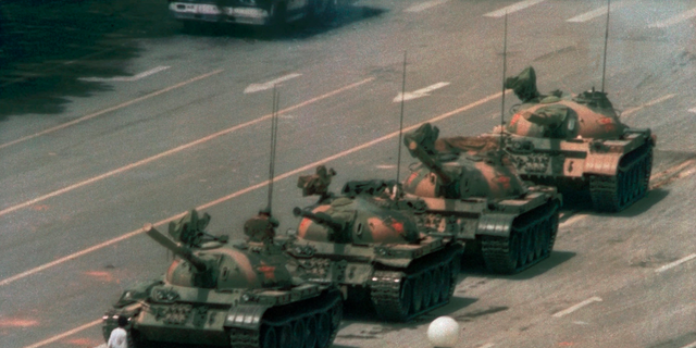 In this June 5, 1989 file photo, a Chinese man stands alone to block a line of tanks heading east on Beijing's Changan Blvd. in Tiananmen Square. (AP Photo/Jeff Widener, File )