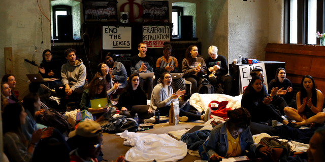FILE - In this April 29, 2019 file photo Swarthmore College students sing during a sit-in at the Phi Psi fraternity house in Swarthmore, Pa. Students at the suburban Philadelphia college have occupied the on-campus fraternity house in an effort to get it shut down after documents allegedly belonging to Phi Psi surfaced containing derogatory comments about women and the LGBTQ community and jokes about sexual assault. School President Valerie Smith announced Friday, May 10, 2019 that fraternities and sororities will no longer be allowed at Swarthmore College. (AP Photo)