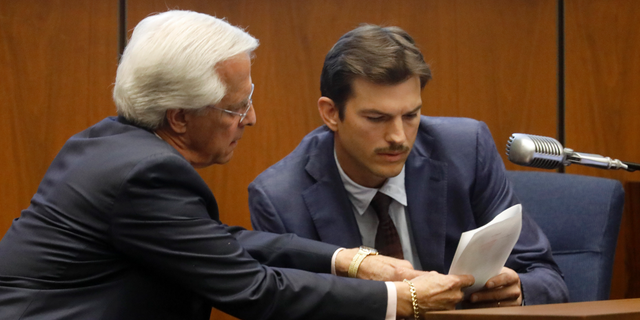 Defense Attorney Daniel Nardoni, left, questions Ashton Kutcher during his tesitimony in the murder trial of Michael Gargiulo in Los Angeles Superior Court, Wednesday, May 29, 2019. Gargiulo, 43, has pleaded not guilty to two counts of murder and an attempted-murder charge stemming from attacks in the Los Angeles area between 2001 and 2008, including the death of Kutcher's former girlfriend, 22-year-old Ashley Ellerin.