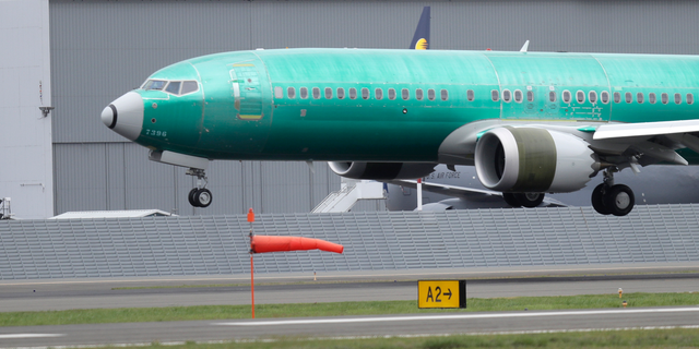 FILE - In this April 10, 2019, file photo a Boeing 737 MAX 8 airplane being built for India-based Jet Airways lands following a test flight at Boeing Field in Seattle. The grounding of Boeing 737 Max jets likely means that fare increases this summer will be larger than already expected and airlines will struggle to handle disruptions such as storms that shut down hub airports. (AP Photo/Ted S. Warren, File)