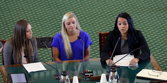 Former gymnasts Jordan Schwikert, left, Amy Baumann, center, and Tasha Schwikert, right, take part in a hearing about the statute of limitations child sex abuse victims have to sue their abusers, Monday, May 13, 2019, in Austin, Texas. In Texas, lawmakers quietly removed a bill's provision allowing child sex abuse victims to sue institutions and are now shielding the very groups that lobbied them to do so. (AP Photo/Eric Gay)