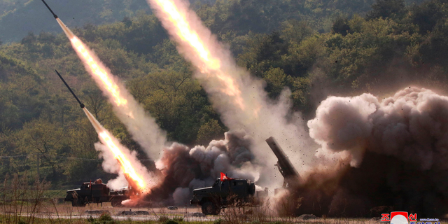This Thursday, May 9, 2019, photo provided Friday, May 10, 2019, by the North Korean government shows a test of military weapon systems in North Korea. (Korean Central News Agency/Korea News Service via AP)