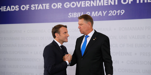 French President Emmanuel Macron, left, is welcomed by Romanian President Klaus Werner Ioannis as he arrives for an EU summit in Sibiu, Romania, Thursday, May 9, 2019. European Union leaders on Thursday start to set out a course for increased political cooperation in the wake of the impending departure of the United Kingdom from the bloc. (AP Photo/Vadim Ghirda)