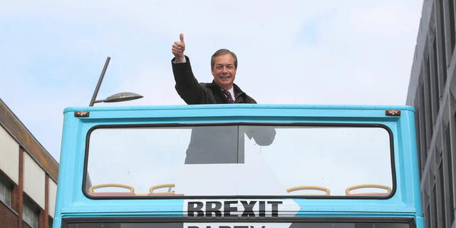 Brexit Party leader Nigel Farage gestures on an open-topped bus while on the European Election campaign trail in Sunderland, England, Saturday, May 11, 2019.