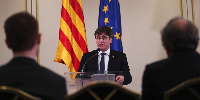 FILE - In this Feb. 18, 2019 file photo, Catalonia's former regional president. Carles Puigdemont, addresses a conference in Brussels. Spanish political party officials said on Monday, April 29, 2019, that Spain's Electoral Board has ruled that Puigdemont and two other Catalan separatists who fled abroad to escape arrest can't stand as candidates in next month's European Parliament elections. (AP Photo/Francisco Seco, File)