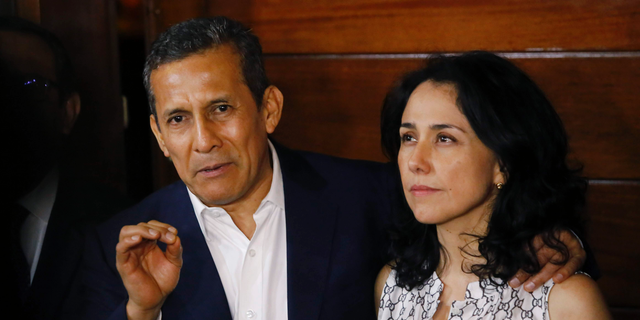 FILE - In this April 30, 2018 file photo, Peru's former President Ollanta Humala accompanied by his wife Nadine Heredia, speaks to reporters at the entrance of their home after they were released from prison, in Lima, Peru. On Tuesday, May 7, 2019, the Peruvian prosecutor's office requested 20 years in prison for former President Ollanta Humala, and 26 years for his wife Nadine Heredia, both who are accused of laundering money they allegedly received from the Brazilian company Odebrecht. (AP Photo/Joel Alonzo, File)
