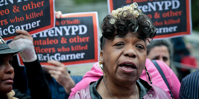 FILE - In this Thursday, May 9, 2019, file photo, Gwen Carr, left, mother of Eric Garner, an unarmed black man who died as he was being subdued in a chokehold by police Officer Daniel Pantaleo nearly five years earlier, speaks during a news conference after leaving court in New York. A long-delayed disciplinary trial is set to begin, Monday, May 13, 2019, for the New York City police officer accused of using a banned chokehold in Garner's death in July 2014. (AP Photo/Bebeto Matthews, File)