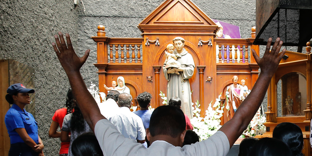 Catholic devotees pray at the St. Anthony's church after it was partially opened for the first time since Easter Sunday attacks, in Colombo, Sri Lanka, Tuesday, May 7, 2019. Two bomb experts were among the suicide attackers who struck churches and hotels on Easter in Sri Lanka and all those directly involved in the bombings are either dead or under arrest, police said. (AP Photo/Eranga Jayawardena)