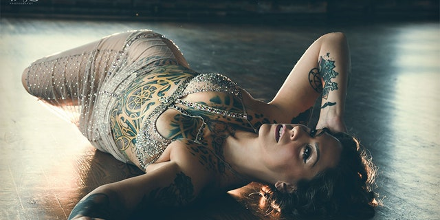 """Danielle Colby stars in the hit History Channel series """"American Pickers"""" by day, but at night she transforms into brunette burlesque beauty Dannie Diesel."""