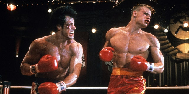 "Sylvester Stallone punches Dolph Lundgren in a scene from the film ""Rocky IV"" in 1985. Stallone said Lundgren nearly killed him during filming, but that they're close friends today."
