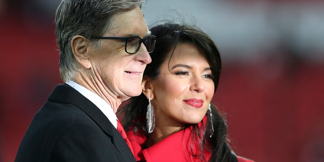 Liverpool FC owner John Henry and his wife Linda Pizzuti pose before the English Premier League soccer match between Liverpool and Huddersfield Town at Anfield Stadium, in Liverpool, England, Friday, April 26, 2019.(AP Photo/Jon Super)