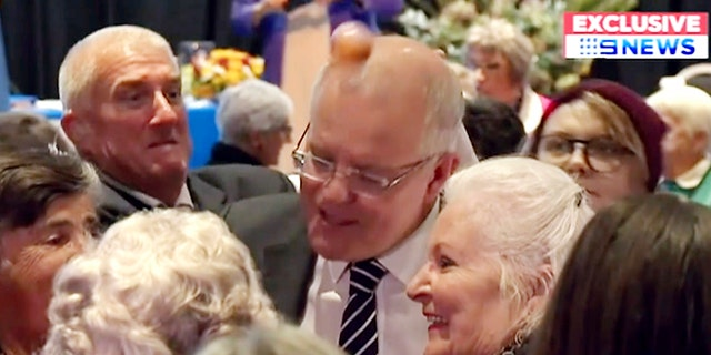 In this image made from video, an egg hits the head of Australian Prime Minister Scott Morrison as he spoke to a rural women's conference in the town of Albury, Australia.