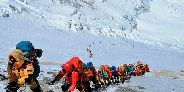 A long queue of climbers ascends Mount Everest in 2019 just below camp four.
