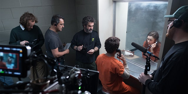Filmmaker Joe Berlinger directs Zac Efron and Lily Collins.