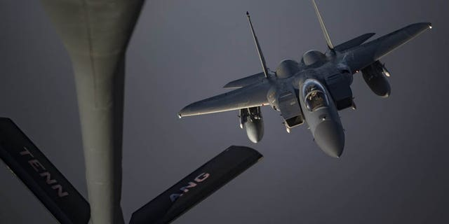 An F-15C Eagle prepares to receive fuel from a KC-135 Stratotanker from the 28th Expeditionary Aerial Refueling Squadron on Sunday at an undisclosed location.