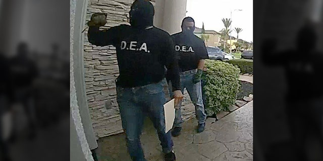 Pearland police are looking for two suspects who allegedly posed as DEA agents to get inside a house.