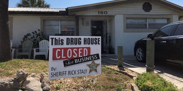 The Flagler County Sheriff's Office posted this sign outside a suspected drug house.