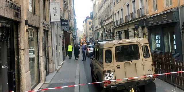 A vehicle belonging to French anti-terror investigators near the site of the attack in central Lyon on Friday.