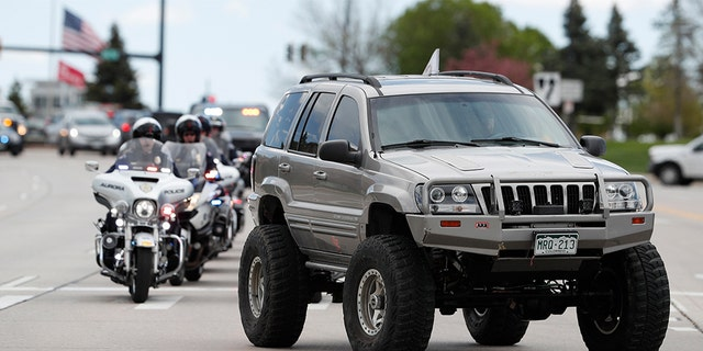 More than 600 Jeeps lead a caravan to the memorial service for Kendrick Castillo, who was killed in the assault on the STEM  School Highlands Ranch on Wednesday. (AP Photo/David Zalubowski)