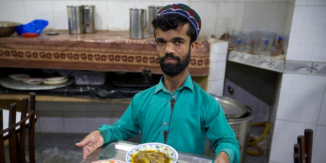 Rozi Khan, a 26-year-old Pakistani who shares a resemblance to the U.S. actor Peter Dinklage, works as a waiter in a small cafe in Rawalpindi, Pakistan.