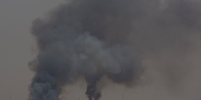 Smoke rises from fires on Israeli farmland caused by arson balloons launched from Gaza City, Wednesday, May 15, 2019.