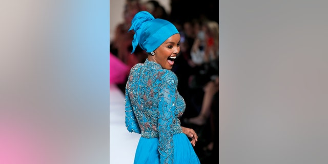Halima Aden walks the runway for the Sherri Hill Show during New York Fashion Week February 2019 on February 8, 2019, in New York City. (Photo by JP Yim/Getty Images for Sherri Hill)