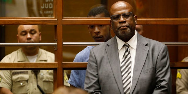 Chris Darden representing Eric Holder in court on April 4.