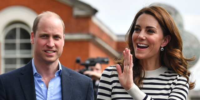 Kate Middleton and Prince William wave to well-wishers as they leave the launch of the King's Cup Regatta at Cutty Sark, Greenwich, on May 7, 2019, in London, England.