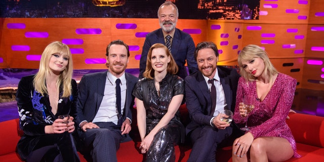 Host Graham Norton with (left to right) Sophie Turner, Michael Fassbender, Jessica Chastain, James McAvoy and Taylor Swift during the filming of the Graham Norton Show at BBC Studioworks 6, Television Centre, Wood Lane, London, to be aired on BBC One on Friday evening. (Photo by Matt Crossick/PA Images via Getty Images)
