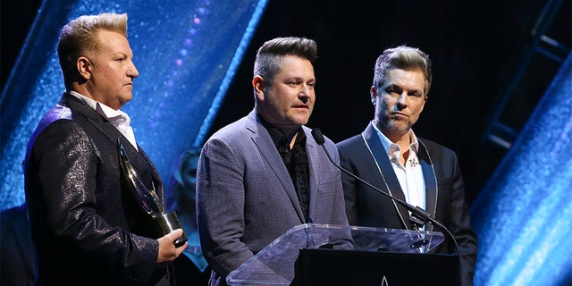 GMA Honorees Gary LeVox, Jay DeMarcus and Joe Don Rooney of Rascal Flatts speak during the 6th Annual GMA Honors and Hall of Fame Ceremony at Allen Arena, Lipscomb University on May 08, 2019 in Nashville, Tenn. (Photo by Terry Wyatt/Getty Images)