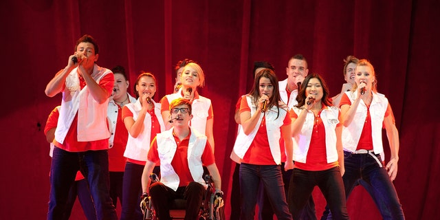 "The cast of Glee performs onstage during the 2011 ""GLEE Live"" Concert Tour"
