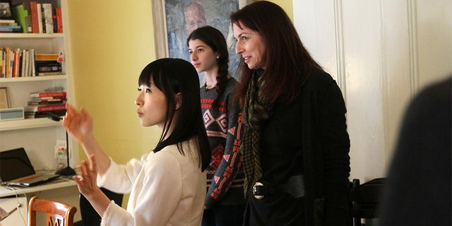 Marie Kondo, zen tidiness guru, speaks in Japanese through an interpreter. Kondo tells Claudia Logan and her daughter Otti,16, there is much joy in their dining room/ office. (Photo by Joanne Rathe/The Boston Globe via Getty Images)