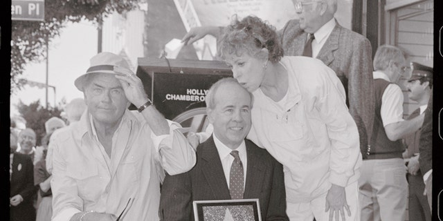 Actor Tim Conway (C) gets a kiss on the head from Carol Burnett (R) and an elbow in the shoulder from actor Harvey Korman (L) after receiving his star on Hollywood Blvd. Conway was awarded the 186th star on the Hollywood walk of fame.