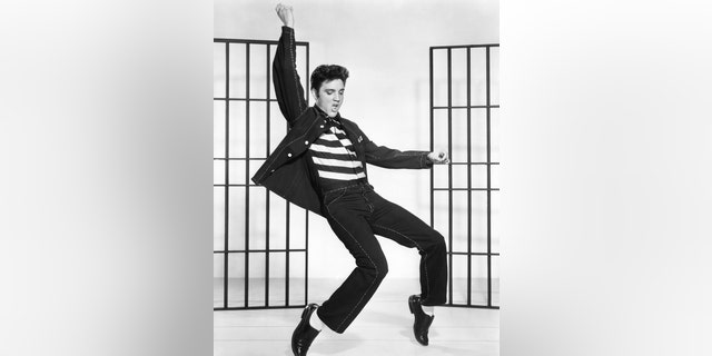 "American singer and actor Elvis Presley on the set of 1957's ""Jailhouse Rock,"" directed by Richard Thorpe. (Photo by Metro-Goldwyn-Mayer/Sunset Boulevard/Corbis via Getty Images)"