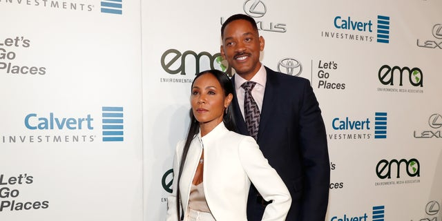 Actors Jada Pinkett Smith (L) and Will Smith attend the Environmental Media Association 26th Annual EMA Awards in Burbank, California