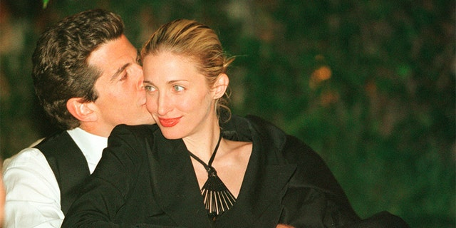 John F. Kennedy, Jr. gives his wife Carolyn a kiss during the annual White House Correspondents dinner May 1, 1999 in Washington, D.C. (Photo by Tyler Mallory/Liaison)