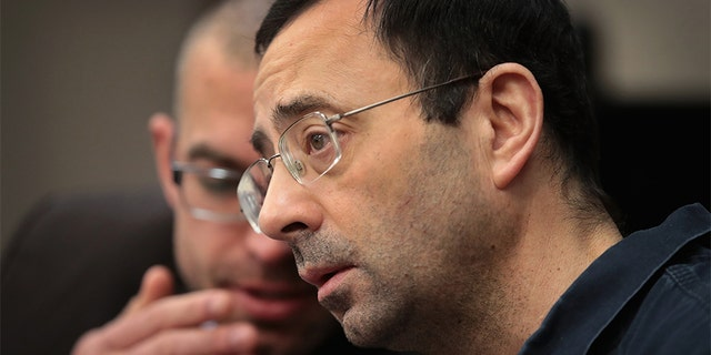 Larry Nassar appears in court to listen to victim impact statements during his sentencing hearing on January 17, 2018, in Lansing, Michigan. He was accused of molesting more than 100 girls while he was a physician for USA Gymnastics and Michigan State University.