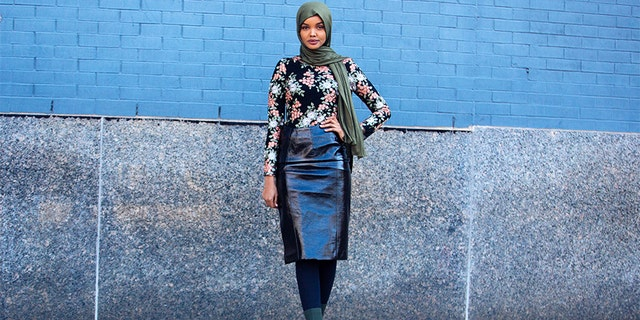 Model Halima Aden wears a green headscarf, black floral top, leather skirt, and green boots on February 8, 2018, in New York City. (Photo by Melodie Jeng/Getty Images)